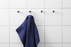 Blue towel white tiles Stock Photography