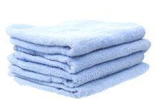 Blue Towels Isolated on White Background Royalty Free Stock Photography
