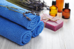 Blue towels and lavender flowers Stock Image