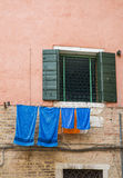 Blue Towels on Pink Stucco Royalty Free Stock Photography