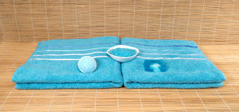 Blue towels with sea salt and soap on bamboo Mat Stock Photography