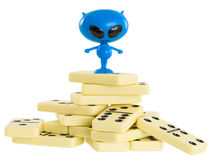 Blue toy alien on a heap from dominoes Royalty Free Stock Photos