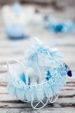 Blue Toy Baby Carriage Prepared as a Gift for Baby Shower. On white wooden background stock photography