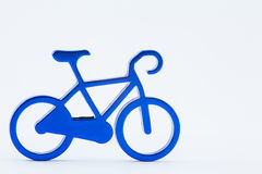 Blue toy bicycle. On white background Royalty Free Stock Image