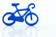 Blue toy bicycle. On white background Royalty Free Stock Images