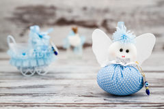 Blue Toy for Boy Prepared as a Gift for Baby Shower. On white wooden background stock images