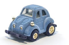 Blue toy car. Isolated blue toy plush car on white background Royalty Free Stock Image