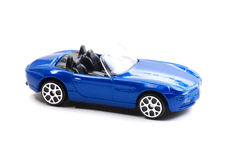 Blue Toy Car. A blue painted toy convertible car against a white backdrop stock photo