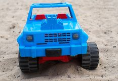 Blue toy car on the sand Royalty Free Stock Photos