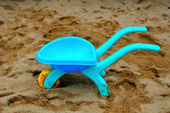 Blue Toy Cart. A blue toy cart/trolley in sands Stock Photo