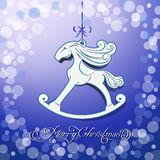Blue toy horse the symbol of new year. Christmas background with a symbol of the new year Stock Photos