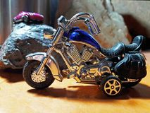 Blue toy motorcycle stock images