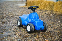 Blue toy tractor Royalty Free Stock Photography