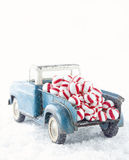 Blue toy truck carrying striped peppermint candy stock images