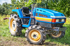 Blue tractor. Blue tractor in the field Royalty Free Stock Photos