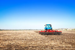 Blue tractor in the field Stock Photo