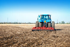 Blue tractor in the field Stock Photography