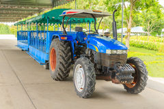 Blue tractor for transportation. Stock Image