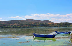 Blue traditional old wooden fishing boats, Greece Royalty Free Stock Photos