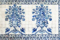 Blue traditional Portuguese ceramic tiles azulejos. Facade, wall decoration of old Coimbra university building, Portugal. Decorative background with ornaments royalty free stock photos