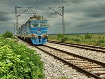 Blue train comes stock images