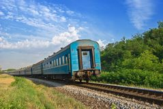 Blue train leaving far Stock Image