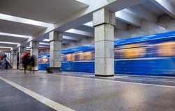 Blue train in motion at subway station Royalty Free Stock Photography
