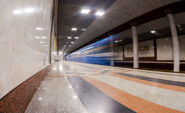 Blue train in motion at subway station Royalty Free Stock Image