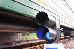 Blue train signal, motion blur Stock Photo