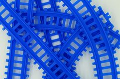 Blue Train Tracks. Detail of blue, plastic, toy train tracks  on white background Royalty Free Stock Photos