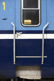 Blue train wagon entrance door in a railway station Stock Images
