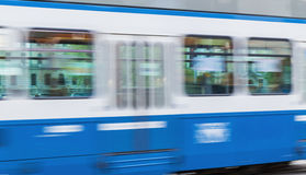 Blue tram on city street with motion blur effect Royalty Free Stock Photo