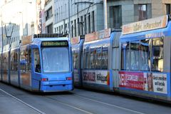 A blue tram in downtown Munich on a bright winter`s morning. A tram passesthrough Munich city centre in January as workers` unions threaten strikes across the Royalty Free Stock Photos