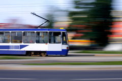 Blue tram rider fast royalty free stock photography