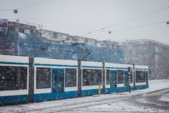 Blue tram in a snowy day. Stock Photo