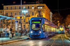 Blue tram in Zagreb. Electric tram in Zagreb. Photo taken on Main train station at night in Octobar Royalty Free Stock Image