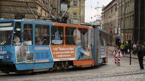 Blue tramway near the Dormition or Assumption church in Lviv, Western Ukraine stock video