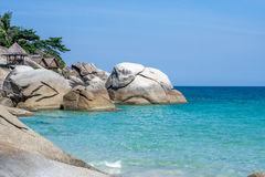 Blue tranquil sea and boulders beach at Koh Phangan, Thailand, Asia. Blue tranquil sea and boulders beach Haad Yuan at Koh Phangan, Thailand, Asia Royalty Free Stock Images