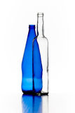 Blue and transparent bottles of glass isolated on white backgrou. Nd Royalty Free Stock Images