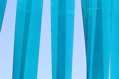 Blue transparent / opaque plastic strips. In the sunlight swaying in the wind - cyan Stock Images