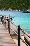 Blue Transparent Sea with wooden bridges Royalty Free Stock Photo