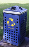 Blue trash can in the park Royalty Free Stock Photos