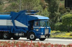 Blue Trash Truck. (front loader) on its way to Landfill in Los Angeles County Stock Photos