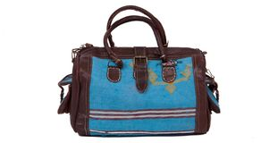 Blue travel bag on a white background Royalty Free Stock Photography