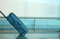Blue travel suitcase. In the airport Royalty Free Stock Photography