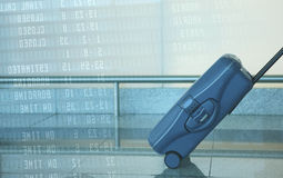 Blue travel suitcase. With departure data on the background Stock Photos