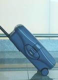 Blue travel suitcase Stock Photo