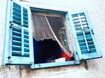 Blue traveling window stock image