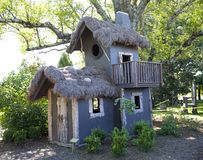 Blue Tree House with a Grass Roof Stock Image