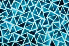 The blue triangle wall. From thegranite to the miror wall - The blue facet wall - facet ground - tile wall Royalty Free Stock Image